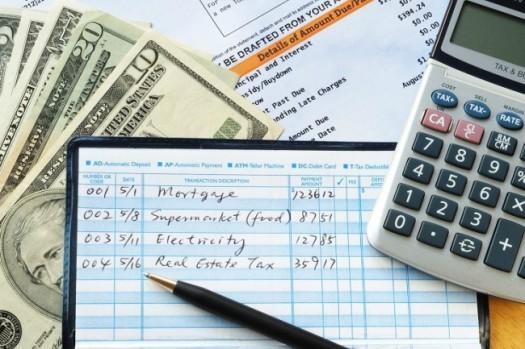bigstock-Write-some-checks-to-make-paym-41096971